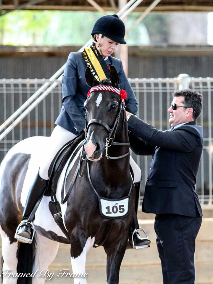 Champion Adult Rider Emma Parlevliet and Paul Austin
