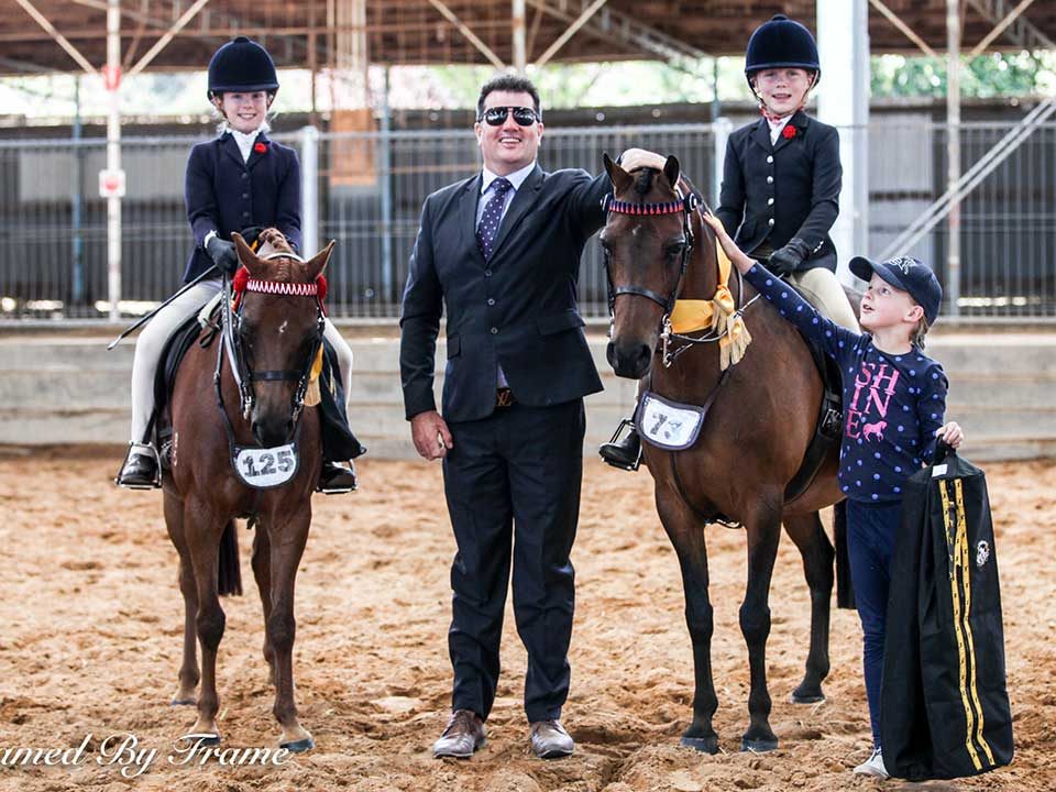 Champion Junior Rider 10 & Under – Champion Evie Torrens, Judge Paul Austin assisting with ears forward for Rose Holland and encouragement award to Ava Holland